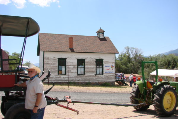 Ron, Tractor Pulling Trolley in front of the Howard Church